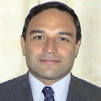 Dr. Ramón Coloma